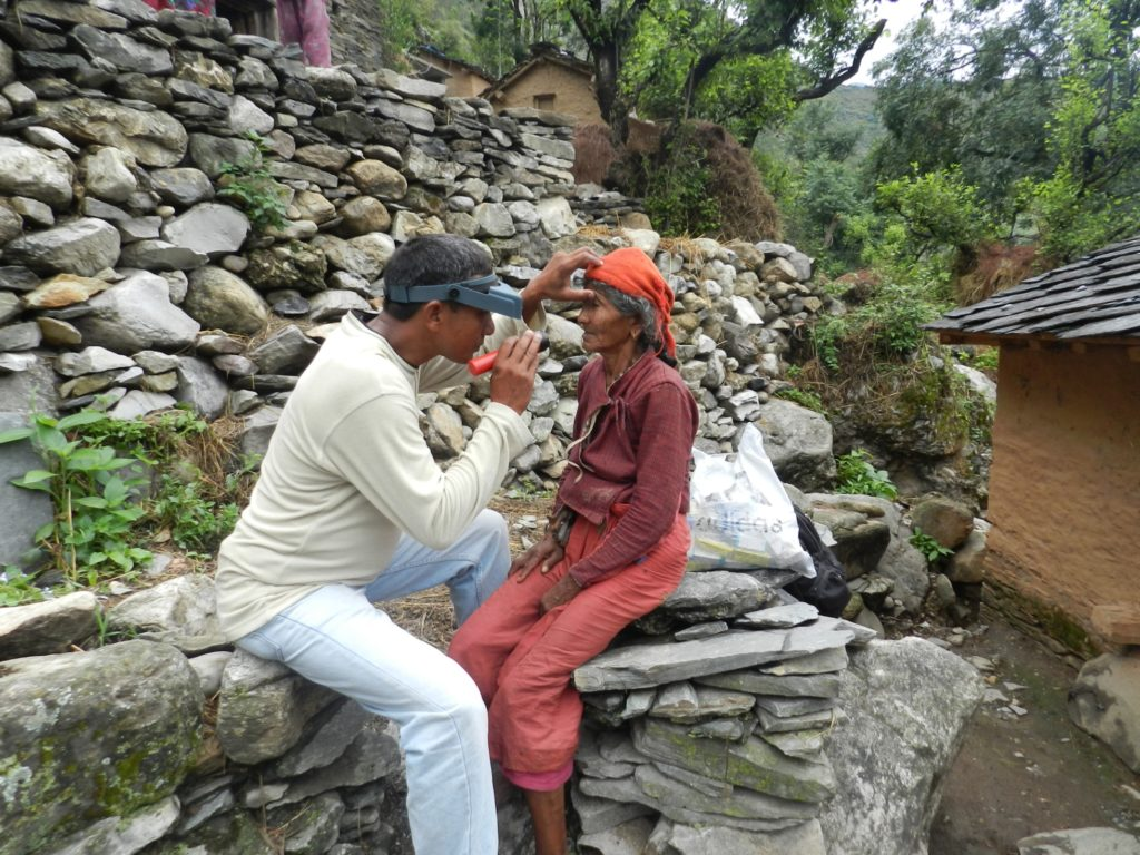 Baitadi, Nepal  An elderly woman being assessed for trichiasis in one of the last trachoma prevalence surveys in Nepal. The World Health Organization validated the elimination of trachoma as a public health problem in Nepal in May 2018.   Photographer: Shekhar Sharma for Nepal Netra Jyoti Sangh