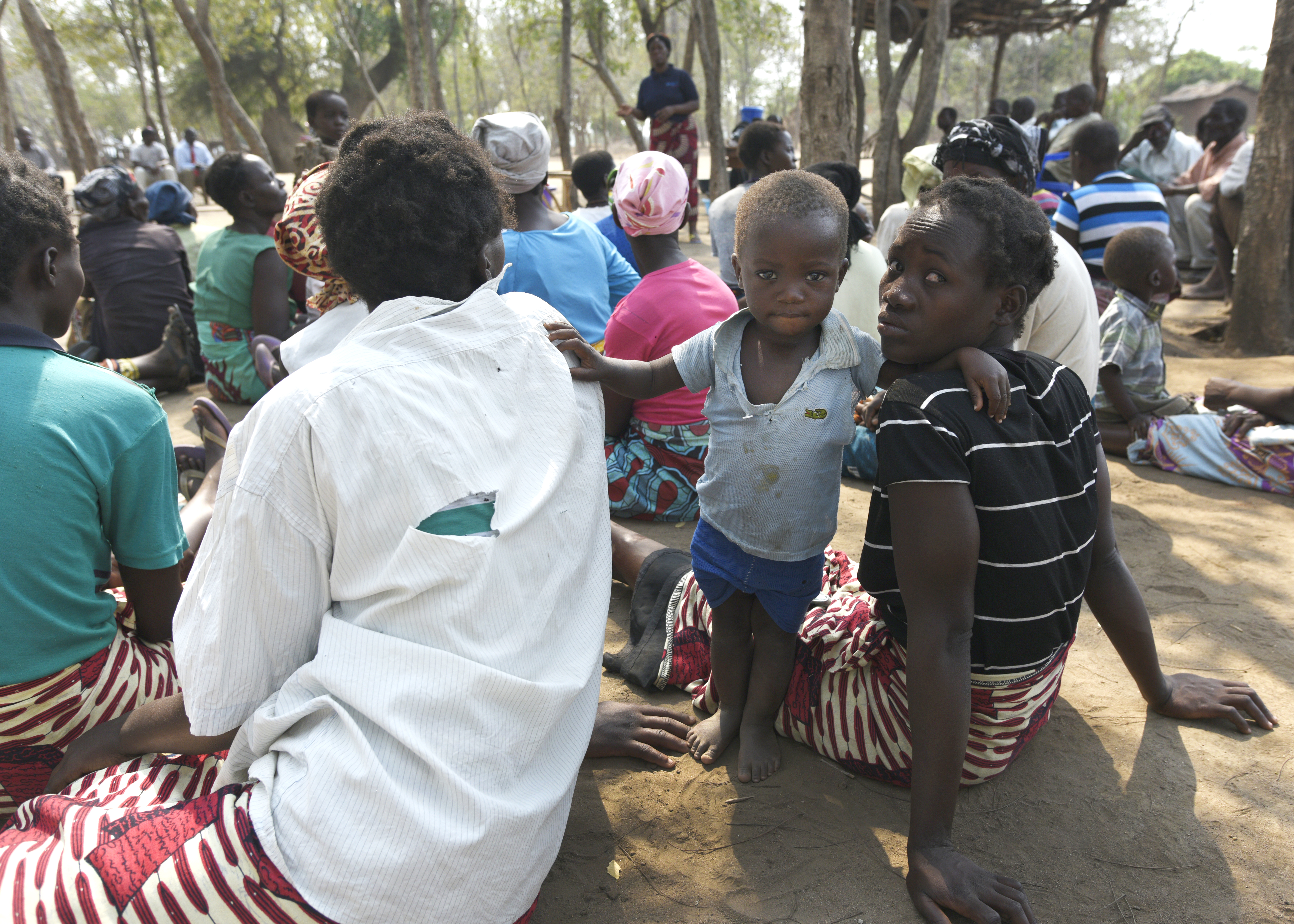 Families wait for antibiotic medication In Chimphepo Village, Chikwawa District, Malawi, a mass drug administration (MDA) is held on Oct. 18, 2016, for the elimination of trachoma. The Task Force for Global Health's International Trachoma Initiative manages Pfizer's donation of antibiotic for MDA, which is part of a comprehensive public health strategy called SAFE to eliminate trachoma. During the weeks of Oct. 17-28, 2016, an estimated 500,000 people in more than 100 communities took part in MDA in Malawi. The country is expected to eliminate trachoma as a public health problem by 2020. Tues. Oct 18th, 2016 (Photo By Billy Weeks)